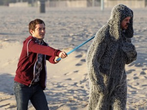 Elijah Wood takes a human for a walk on Venice beach.